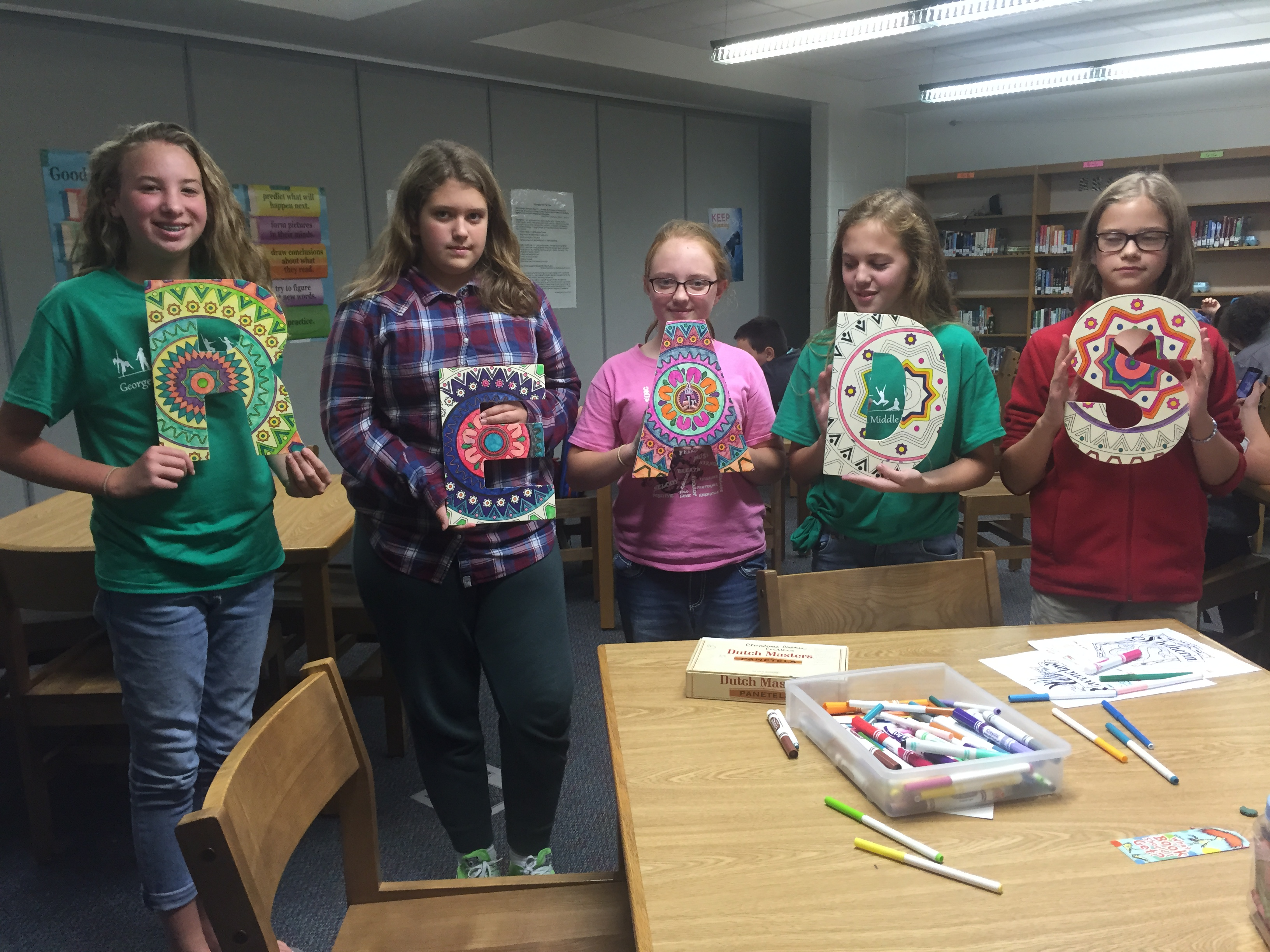"Reading Club students colored the letters ""R E A D S"" to decorate the library"