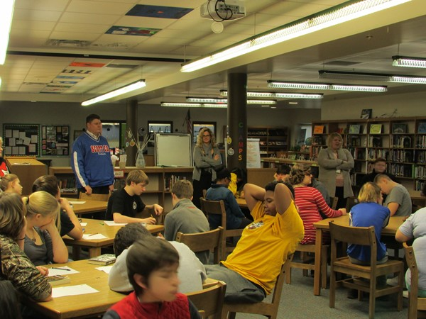 Dr. Hub and 8th graders discussing the book