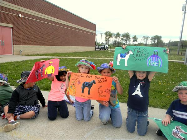 1st Grade Classes cheer on their classmates running in the Derby.