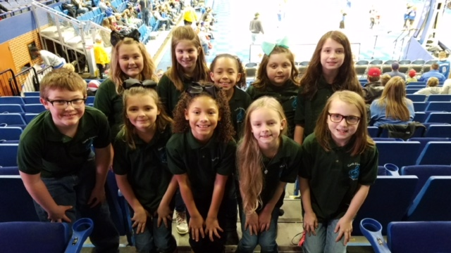 Students Sing at Harlem Globetrotters Game